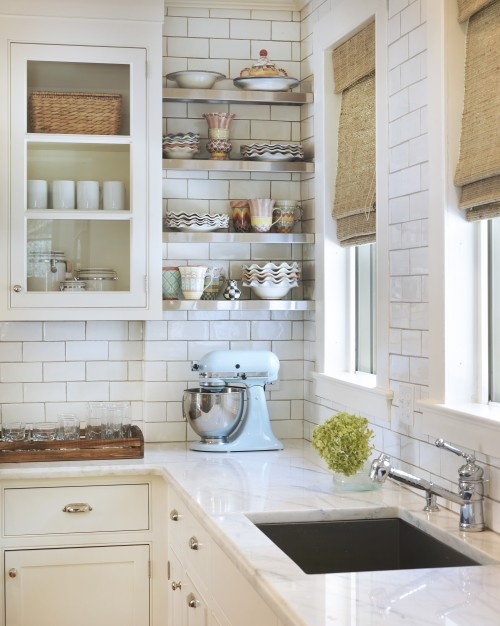 Subway tile for the backsplash and higher - what a cool look. Click the picture to find out more about this kitchen and the tiles.